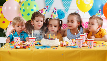 children's birthday. happy kids with cake and ballons Archivio Fotografico