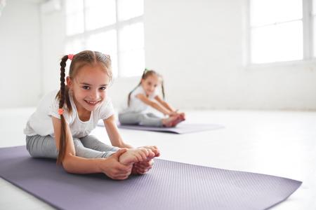 children girls doing yoga and gymnastics in the gym Standard-Bild - 108163343
