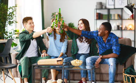 group of happy young  friends with beer and pizza at home Banco de Imagens