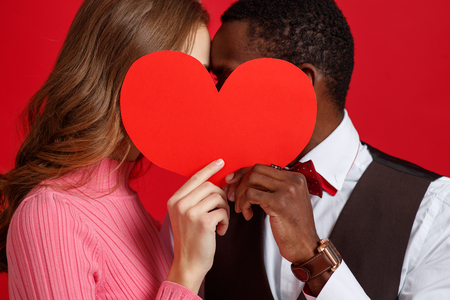 valentines day concept. happy young couple with heart on red background Banco de Imagens