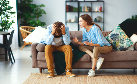 a family couple quarrels in a conflict at home