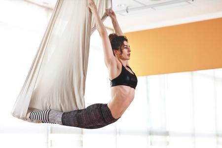 Woman doing of Aero yoga of antigravity in a hammock