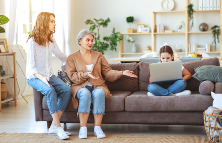 Child with a laptop on the internet, internet addiction, parents scold Stock Photo