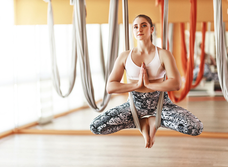 Woman doing of Aero yoga of antigravity in a hammock