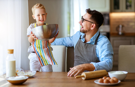 Happy family in kitchen. Father and child son baking cookies together Stok Fotoğraf
