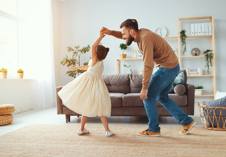 Happy fathers day! Family dad and child daughter Princess dancing at home Stok Fotoğraf