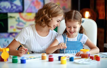 mother and child daughter painting draws are engaged in creativity in kindergarten Stock Photo - 129114876