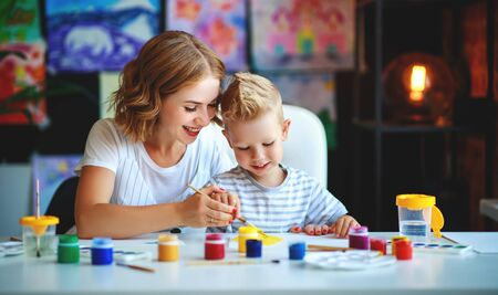 mother and child son  painting draws are engaged in creativity in kindergarten Stock Photo - 129114888
