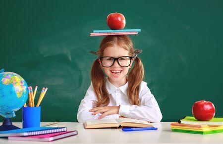 funny happy child   schoolgirl  girl student about school blackboard Stok Fotoğraf