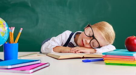 the child   boy student tired, asleep about school blackboard