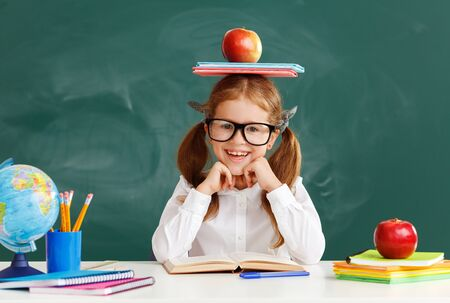 funny happy child  girl student about school blackboard