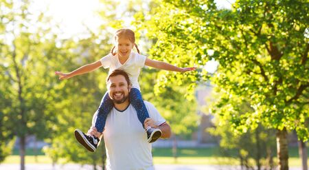 concept of fathers day! happy family dad and child daughter   in   Park in nature