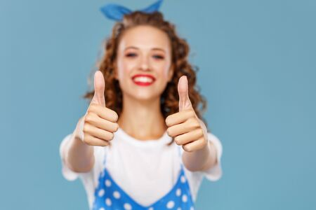 young beautiful funny girl on colored blue background