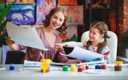 mother and child daughter painting draws are engaged in creativity in kindergarten Stock Photo - 129114987