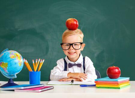 funny happy child  boy student about school blackboard Stok Fotoğraf