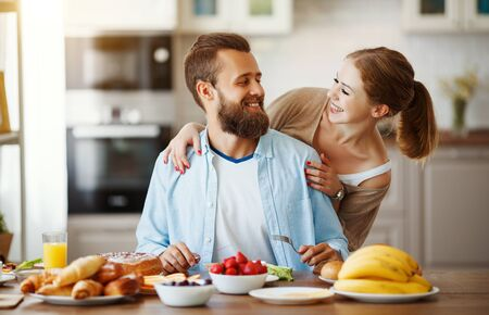family happy couple have Breakfast in the kitchen in morning