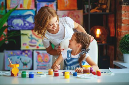 mother and child daughter painting draws are engaged in creativity in kindergarten Stock Photo - 129115531