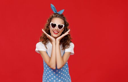 young beautiful funny girl on colored red background Stok Fotoğraf