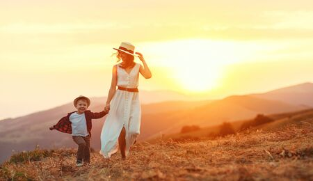 Happy family mother and child son laughing and playing in nature Stok Fotoğraf