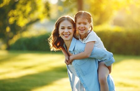 happy family mother and child daughter in nature Park in summer on green grass Stok Fotoğraf
