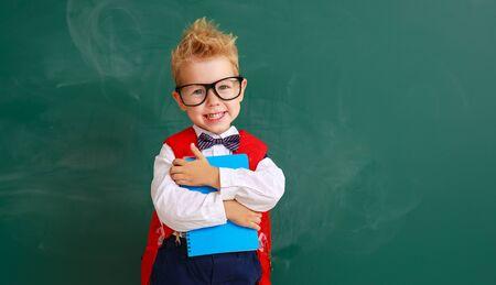 funny happy child boy student about school blackboard