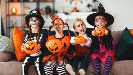 happy Halloween! a group of children in suits and with pumpkins in home Stok Fotoğraf