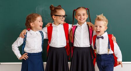 funny happy group children   student boy  and girl about school blackboard
