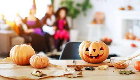 Happy Halloween! the pumpkin Jack lantern with carved smile for family holiday at  home Archivio Fotografico - 129633637