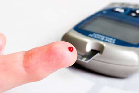 fingertip: Diabetic is doing a glucose level finger blood test