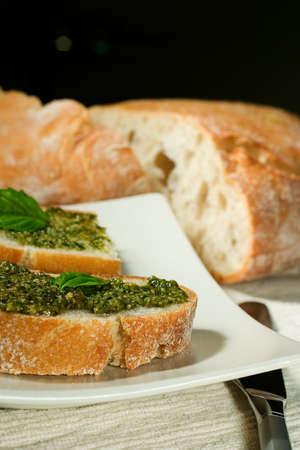 Organic ciabatta bread with pesto dressing photo