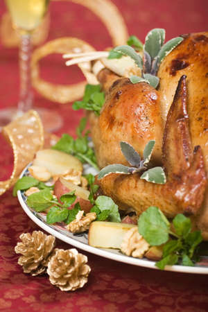 Garnished turkey on Christmas decorated table with flute of champagne on background Stock Photo - 624907