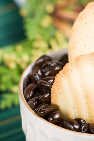 Petite French cakes Madeleines inside a cup full of coffee beans in Christmas decoration Stock Photo - 651507