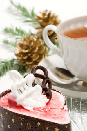 Delicious raspberry souffle cake and cup of tea on Christmass morning Stock Photo - 651502