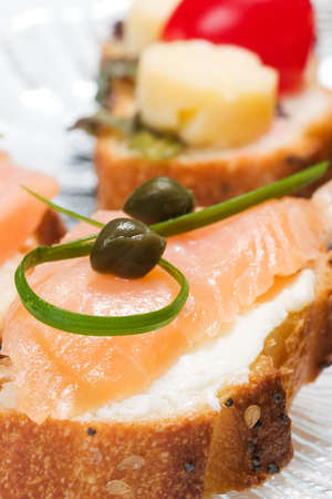 capers: Closeup of smoked salmon with capers canape ready to eat Stock Photo