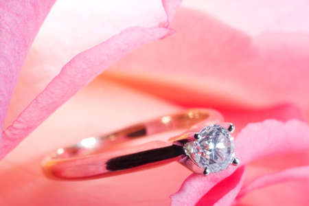 way to present a diamond ring inside beautiful rose on Valentine day. photo