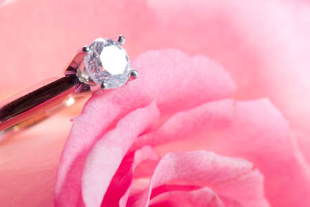 Romantic way to present a diamond ring inside beautiful rose on Valentine day. photo