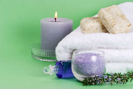 Spa set with rosemary  with copyspace over green paper background best suited for relaxing and health commercials Stock Photo - 731971