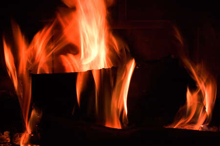 Flames in a fireplace in anybody house at cold weather photo
