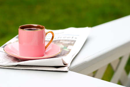 Cup of coffee and todays newspaper is a good start for a day