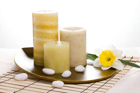 usage: Spring relaxation spa set with candles and spring daffodil flower, suited for spa and healthy lifestyle usage.