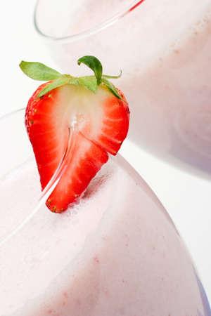 Closeup of strawberry milkshake and strawberry garnish