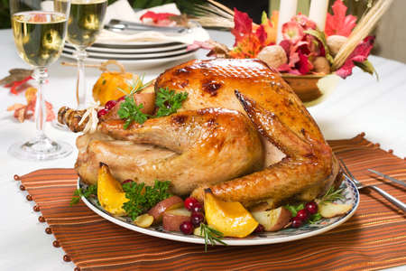 Feasting backed turkey on holiday table ready to eat photo