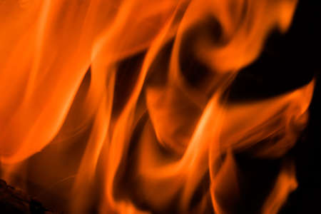 fireplaces: Flames in a fireplace in anybody house at cold weather Stock Photo