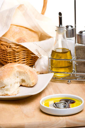 balsamic: Extra virgin olive oil with balsamic vinegar and fresh Italian bread on wooden cut board