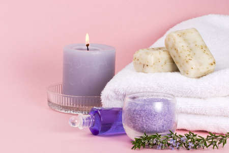 Spa set - aroma candle, salt, oil and organic soap - with rosemary over pink background best suited for relaxing and health commercials