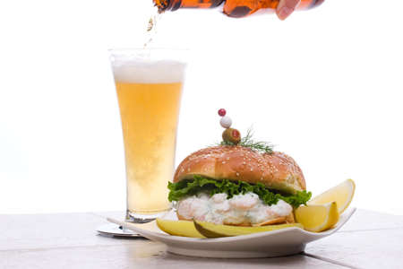 The rich-tasting, but low-calorie filling with shrimps delicious sandwich and glass of beer photo
