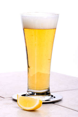 Glass of fresh cold beer with slice of lemon Stock Photo - 1551676
