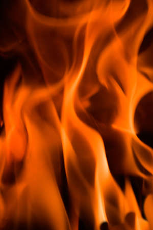 Flames in a fireplace in anybody house at cold weather Stock Photo - 1806913