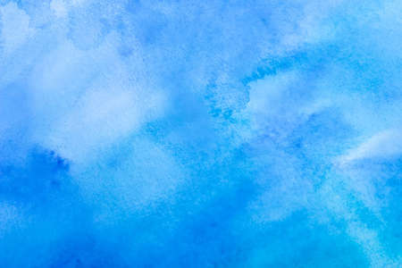 water stained: Wet on wet watercolor abstract homemade background, blue