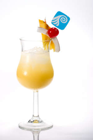 colada: Pina Colada cocktails. Rum, pineapple juice, coconut cream  garnished with slice of pineapple, coconut and maraschino cherry. Most popular cocktails series. Stock Photo